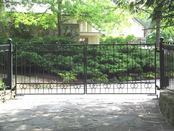 Transitional wrought iron gate by Tri State Gate