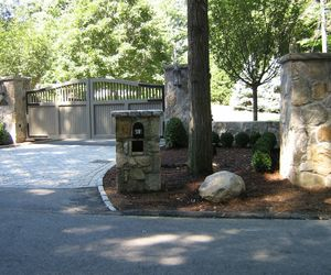 Painted composite swing gate with mailbox holder to match the stone pillars