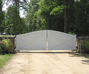 Solid wood ranch-style driveway gate by Tri State Gate, New York