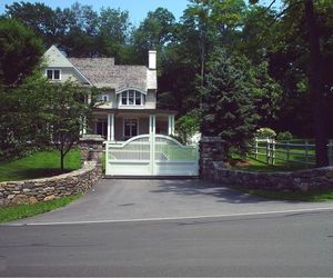Small, residential automatic driveway gate by Tri State Gate, New York