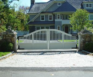 Traditional design swinging automatic gate by Tri State Gate, New York