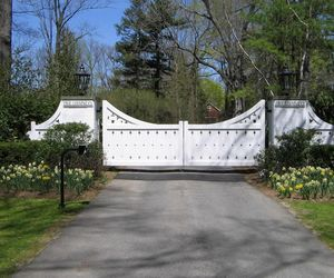 Composite driveway gate customized with die-cut design by Tri State Gate, New York