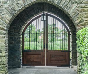 Spanish/Moroccan-inspired arched driveway gate design with vestibule entry by Tri State Gate, New York