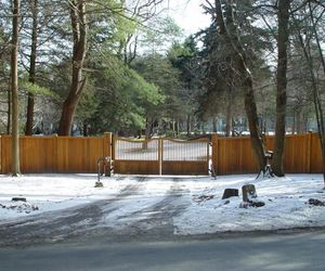 Cedarwood automated gate with secure entry by Tri State Gate, New York