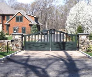 Forest green ranch/farm style driveway gate by Tri State Gate, New York