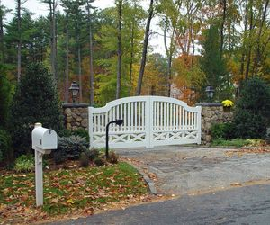 Unique ranch-style gate with keypad entry by Tri State Gate, New York