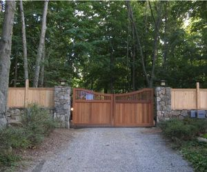 Automated cedar wood driveway gate by Tri State Gate, New York