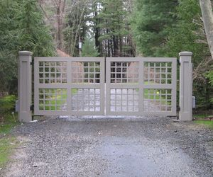 Trellis-style wooden driveway gate by Tri State Gate, New York