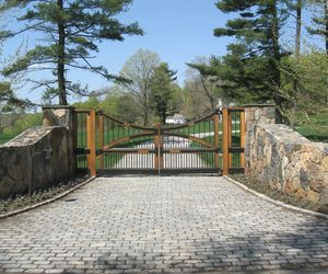 Spanish-inspired wooden driveway gate by Tri State Gate, New York