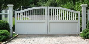 Little white wooden driveway entry gate