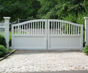 White wood driveway gate by Tri State Gate, New York