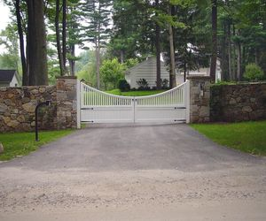 Scalloped wood driveway gate with keypad entry by Tri State Gate, New York