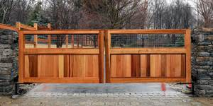 Little custom cedar wooden driveway automated gate
