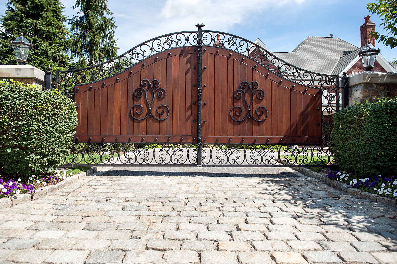 Combination wood and iron driveway gate
