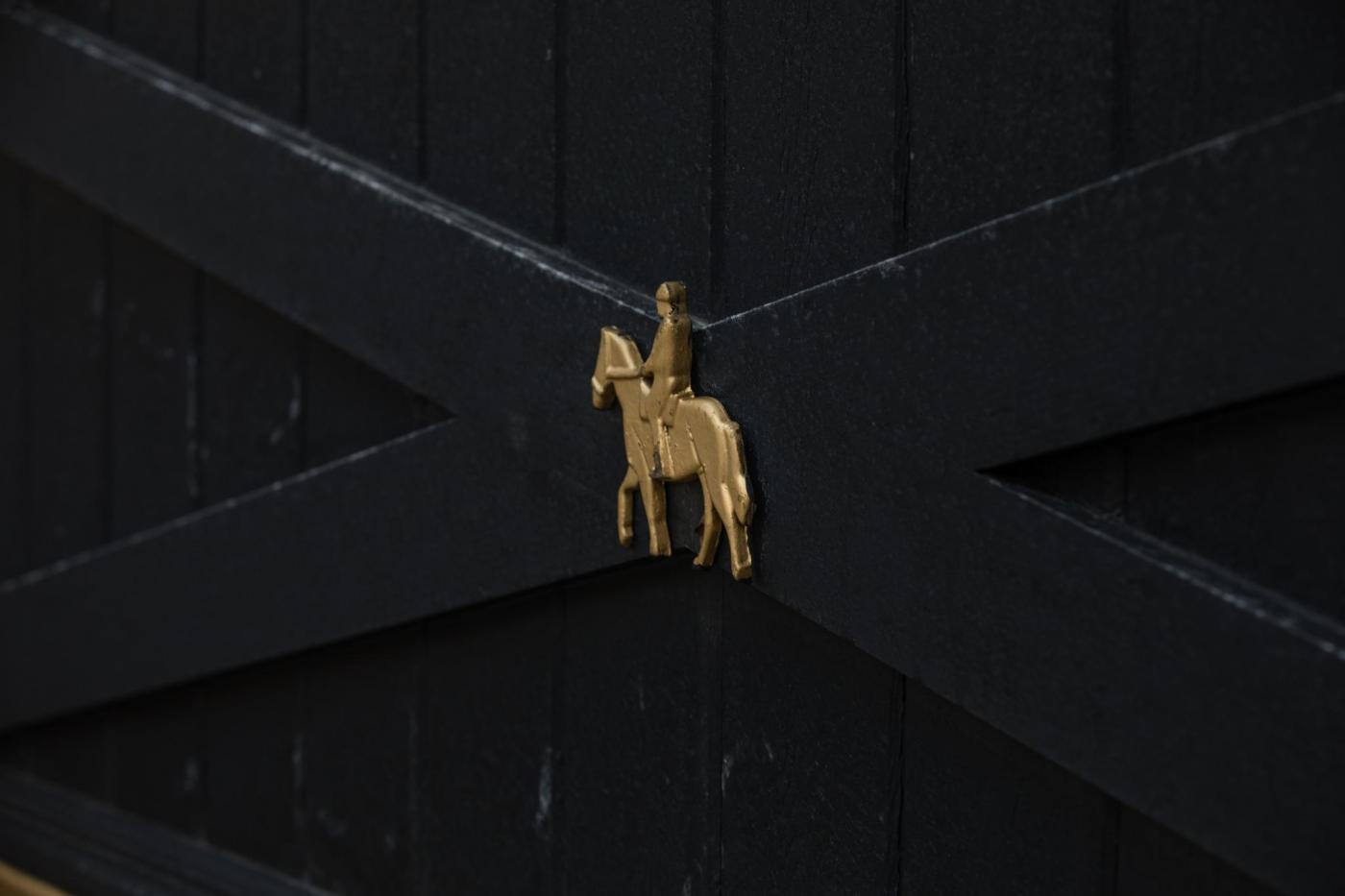 Custom horse and rider metal cutouts for a driveway gate