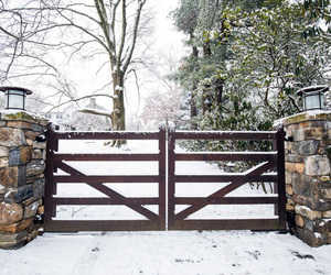 Simple wooden automatic driveway gates