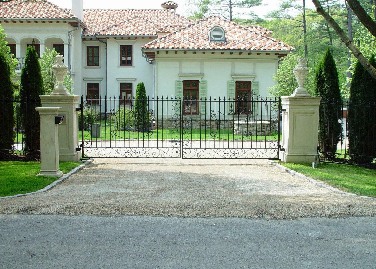Custom Wrought Iron Gate Design With Concrete Pillars, Stone Statues, And  Wrapped Keypad Post