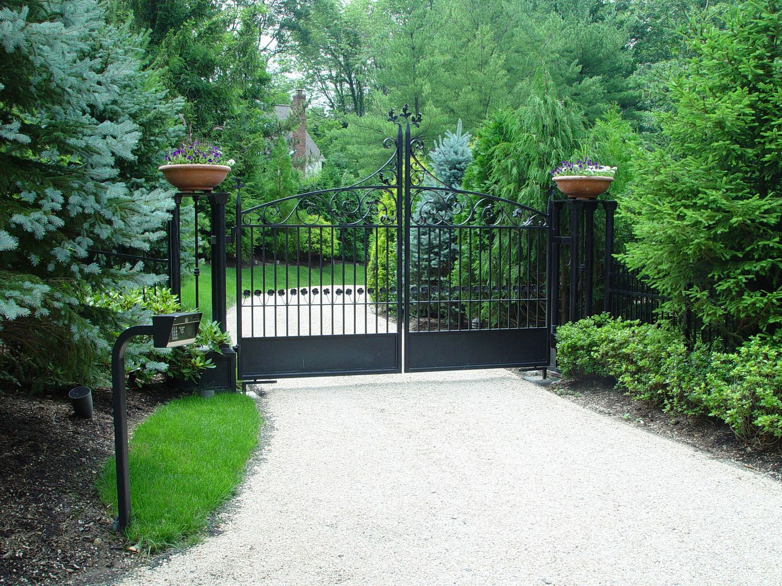 Metal driveway gate with planters
