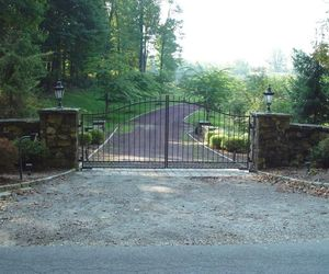A custom-designed, automated iron gate for a residential neighborhood in New York by Tri State Gate