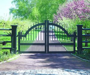 A transitional-style, composite driveway security gate