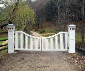 White wood gate, wood-wrapped posts with integrated lighting by Tri State Gate, New York