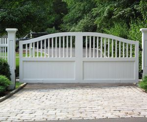White driveway swing gates with wrapped posts by Tri State Gate, New York