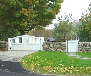 Classic white driveway gate with matching pedestrian gate by Tri State Gate, New York