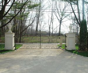 Wrought-iron entrance gate and custom pillars for a gated community in New York, by Tri State Gate