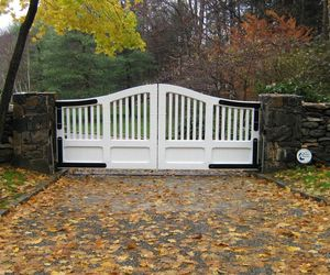 White wood composite with black metal hinges by Tri State Gate, New York