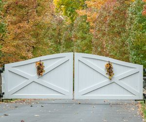 Classic white wood automated driveway gate by Tri State Gate, New York