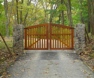 Cedar wood automatic driveway swing gate by Tri State Gate, New York