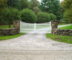 White picket driveway gate design by Tri State Gate, New York