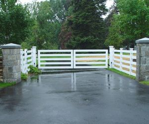 Modern wooden automated driveway gate by Tri State Gate, New York