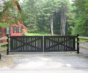 Modern ranch design wooden automated swing gate by Tri State Gate, New York