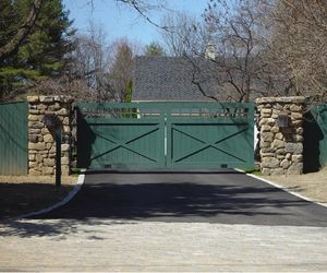 Solid wood painted driveway gate with automated swing doors, by Tri State Gate, New York