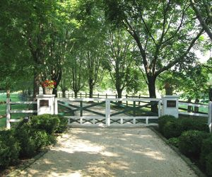 Traditional farm wooden gates with white and green paint, by Tri State Gate, New York