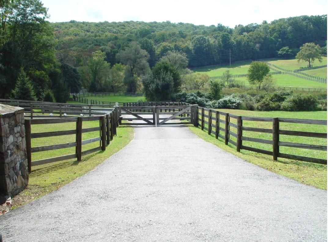 Split rail wood fence gate Lionelkearns Automated Wood Gate With Postandrail Fencing On Farm Property Tri State Gate Wooden Driveway Gates Tri State Gate