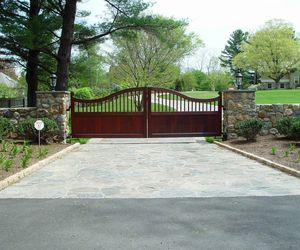 Mahogany automatic wooden gate design by Tri State Gate, New York
